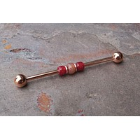 Red Beaded Rose Gold Industrial Barbell Piercing Scaffold