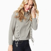 Tia Lace-Up Sweatshirt | Charming Charlie