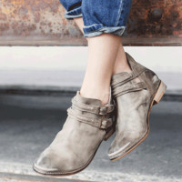 Stay true to your hip style with these trendy Braeburn Cutout Ankle Round Toe Rugged Leather Booties by Free People! Featuring rugged leather upper and underlining, round toe, unique adjustable strap with brass buckles design, side cut out, flat stacked he