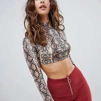 Sacred Hawk crop top in snake print at asos.com