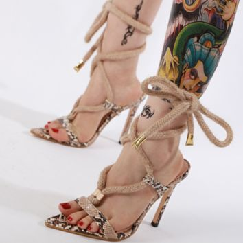 The new snake-print sandals with ultra-high pointed eyes are for women