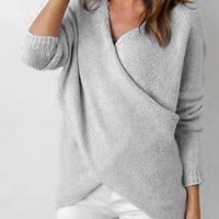Cross-knit sweaters with long sleeves