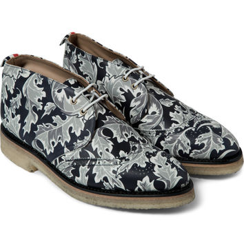 Thom Browne Navy Leaf Camo Print Wingtip Chukka Boots | HYPEBEAST Store. Shop Online for Men's Fashion, Streetwear, Sneakers, Accessories