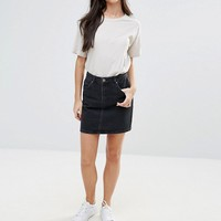ASOS PETITE Denim Original High Waisted Skirt in Washed Black at asos.com