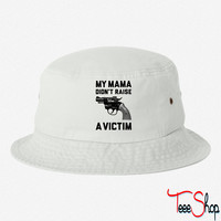 My Mama Didnt Raise A Victim bucket hat