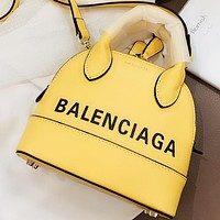 Balenciaga New fashion letter print leather shell shape shoulder bag crossbody bag handbag Yellow