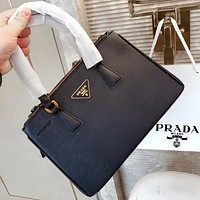 Prada classic bag with simple and square lines and tough triangle embellishment Black