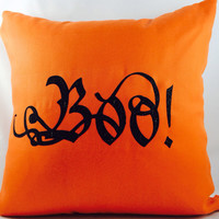 """Fall & Halloween """"BOO"""" toss pillow with black glitter on orange outdoor fabric with coordinating orange chevron backing"""