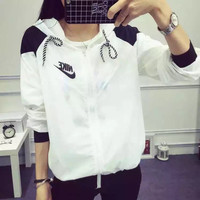 """Nike"" Women Casual Fashion Multicolo Letter Print Long Sleeve Zip Hooded Sunscreen Clothes Windbreaker Coat"