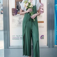 This unique design oversize jumpsuit features a super soft micromodal fabrication, sweetheart neckline, spaghetti straps, wide leg silhouette with wrap around paneling construction with self-tie straps can be tie at front or back. Unlined. Lay with with bl