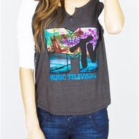 MTV Women's Henley Shirt by Junk Food features the well known MTV logo colored with grafitti style paint. Super soft triblend charcoal grey henley, with white 3/4 sleeves, made by Junk Food in the USA