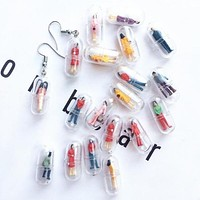 Human Capsule Earrings
