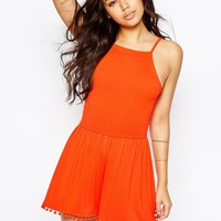 ASOS | ASOS 90's strappy Playsuit with Tie Back and Pom Pom Hem at ASOS