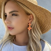 Grew On You Coral Lily Earrings