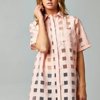 This classic button up woven-like-shirt-tunic features semi-sheer fabrication, mesh panels, hidden button up front, short sleeves, and an high low hemline. Pair with bandeau top and blue skinny jeans or denim shorts.
