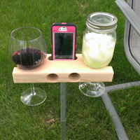 The Wine Dock -perfect for a gift.  Wine Glass Holder and Smartphone Dock/Speaker. Works w/ most smartphones including iPhone 6 6+ & galaxy