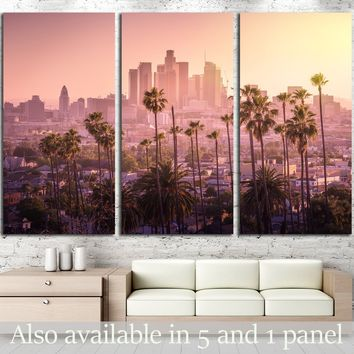 Beautiful sunset of Los Angeles downtown skyline and palm trees in foreground  №2708