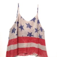 This Patriotic print super soft thin knit perfect for your everyday wear or for your 4th of July celebration, it's lightly cropped top style features red and beige stripes, blue and contrasting stars at upper body throughout, spaghetti shoulder straps, and