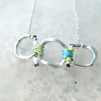 Spring 2014 Collection Silver Ring Necklace with Light Green and Light Blue Cords