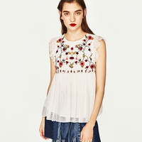 EMBROIDERED TOP DETAILS
