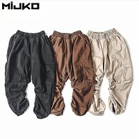 2017 New Water Washed Ankle Length Pants Men High Street Loose Pant Mens Elastic Waist Huge Pockets Vintage Fashion Pants Man XL