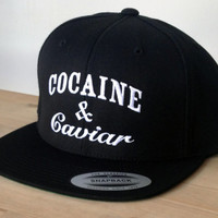 Cocaine and Caviar Cap with Custom Embroidered Logo.  Made to order quality snap back hats and designs