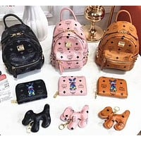 MCM classic printed backpack + coin purse + three-piece puppy accessory