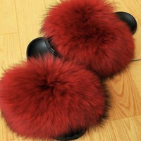 Red raccoon fur slides