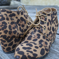 Montana Suede low wedge lace-up bootie | Leopard