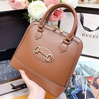 Hipgirls GUCCI New fashion solid color leather shell shape shoulder bag handbag Brown