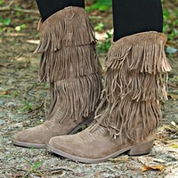 Our Run To Me Boots in Taupe are perfect for the Southern Fried Country Chic in you! They feature a vegan suede leather, triple layer fringe and an intricate design on the foot.