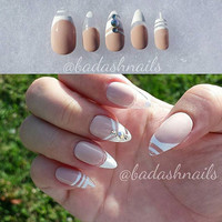 Clear fake nails with nude - white design and crystals