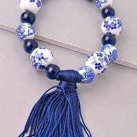 China Doll Tassel Bracelete