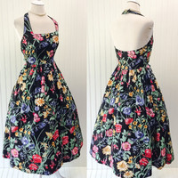 Maxine dress // 1980s does 50s black floral print halter neck full sweep pinup // pockets & backless // size M 36 bust