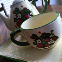 Strawberry Teapot, matching teacup and plate 3 pieces lined in green a great add to your collection!