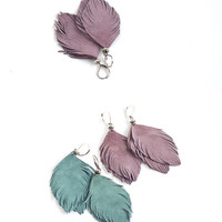 Set of two pairs feather earrings from smoky blue and smoky violet suede leather.