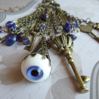 Steampunk Evil Eye Pendant, Eye necklace on bronze chain with many blue luster beads, chains and keys