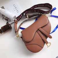 Dior MINI SADDLE BAG IN BROWN CALFSKIN