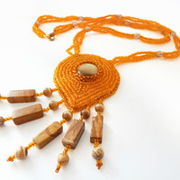 Beaded necklace The Sun of Savanna - orange embroidered seed bead jewelry - handmade beadwork with jasper and cats eye - leather backside