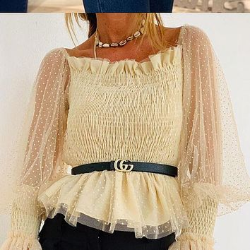 The new chiffon sweater with open back ruffled net and puffed sleeves