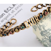 Dior pink yellow blue and green bracelet