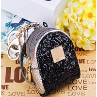 New creative hand with cute cartoon creative sequins purse new material backpack ornaments keychain Black