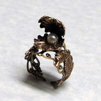 Oyster of the Sea guarding its pearl Sea Horse Band by ranaway