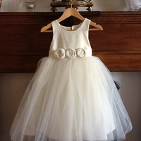 Flower girl dress , cotton, silk or satin with 3 layers of soft tulle over skirt