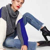 COLOR BLOCK CABLE KNIT SWEATER DETAILS