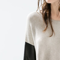 Sweater with faux leather sleeves