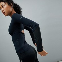 Nike Training Cross Back Top In Black at asos.com