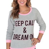 long sleeve top with 'keep calm & dream on' screen and pink binding