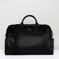 ASOS Holdall In Black Faux Leather With Foil Emboss at asos.com