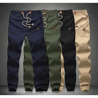 Slim Solid Jogger With Embroidered Detail